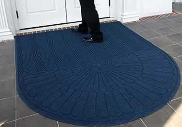 Floor mats made from post consumer recycled products