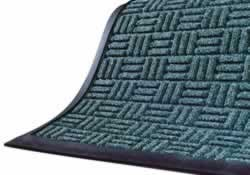 Commercial main entrance floor mats trap dirt, water,  slush and snow